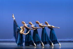 five dancers in blue